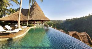 The pool and restaurant at the Viceroy Bali