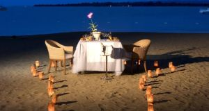 Casa Colonial Beach & Spa's Dominican Republic honeymoon package includes a torch-lit three-course dinner served on the beach