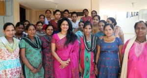 Working mothers: Dr Nayna Patel with the women of her 'baby-making factory' in House of Surrogates