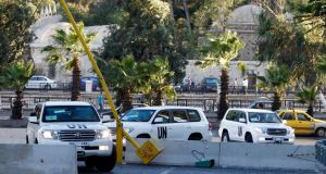 UN vehicles transporting a team of experts from the Organisation for the Prohibition of Chemical Weapons are pictured as they return to their hotel in Damascus today. Photograph: Khaled al-Hariri/Reuters