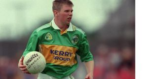 A youthful Tomás Ó Sé weighs up his options during his 1998 debut season in the green and gold of Kerry. Photograph: Patrick Bolger/Inpho