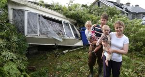 Noel and Mary Kelly with their children Adam and Grace at their mobile home from which they had a lucky escape during the freak weather at Killoran, Clonfert. Photograph: Joe O'Shaughnessy.
