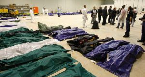 Victims of the  disaster lie  in a hangar of  Lampedusa airport. Photograph: Reuters