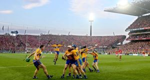 Clare players celebrate at the final whistle of the All-Ireland replay against Cork. Photograph: James Crombie/Inpho
