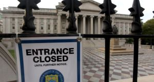 A closed sign hangs at the entrance to the US treasury building in Washington D.C. Photograph: Julia Schmalz/Bloomberg