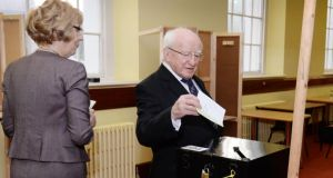 President Michael D Higgins and Sabina Higgins casting their votes at St Mary's Hospital Voting Centre, Phoenix Park. Photograph: Alan Betson/The Irish Times