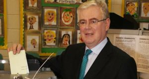 Tanaiste Eamon Gilmore votes at Scoil Mhuire in Shankill, Co Dublin this morning. Photograph: Stephen Collins /Collins Photos