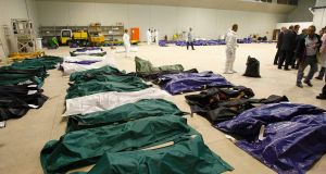 Body bags containing African migrants, who drowned trying to reach Italian shores, lie in a hangar of the Lampedusa airport. Photograph: Antonio Parrinello/Reuters