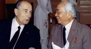 Former French president Francois Mitterrand (left) speaks with former Vietnamese General Vo Nguyen Giap during a state banquet in this Hanoi in  1993. Photograph: Jacky Naegelen/Files/Reuters