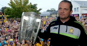 Clare manager Davy Fitzgerald with the Liam MacCarthy cup  at his home town of Sixmilebridge. Photograph: James Crombie/Inpho