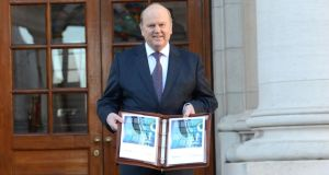 Michael Noonan outside the Dáil before delivering last year's budget. Photograph: Dara Mac Dónaill