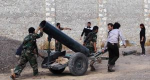 Free Syrian Army fighters move a mortar in Ain-Assan village in Aleppo yesterday. Photograph: Reuters/Molhem Barakat