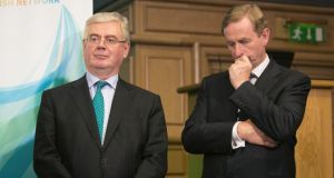 Tánaiste Eamon Gilmore Taoiseach Enda Kenny TD at the announcement yesterday.