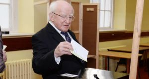 President Michael D Higgins  casting his vote at St Mary's Hospital voting centre, Phoenix Park in the Referendum on the Abolition of the Seanad and Court of Appeal Referendum. Photograph: Alan Betson/The Irish Times