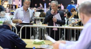 Minister for Jobs Richard Bruton and Fine Gael's campaign director, at the counting of votes for two referendums at the Dublin city count centre in the RDS Dublin. Photographer: Dara Mac Dónaill/The Irish Times