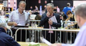 Counting of votes under way for the two referendums at the Dublin city count centre in the RDS Dublin. Photographer: Dara Mac Dónaill/The Irish Times