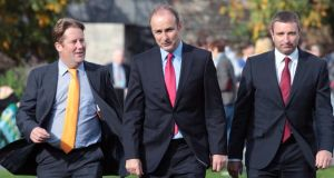 Fianna Fail Senator Darragh O'Brien(from left), party leader Micheal Martin and TD Niall Collins arrive at Dublin Castle today. Photograph: Niall Carson/PA Wire
