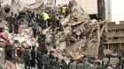 File photo: Rescue workers in Nairobi, Kenya sift through rubble to find survivors trapped in the remains of Ufundi house which collapsed when a huge bomb went off August 7th, 1998. Senior al Qaeda figure Anas al-Liby, indicted by the United States for his alleged role in the 1998 bombings of US embassies in East Africa, was captured  overnight in Libya by a US team. Photograph: Antony Njuguna/Reuters.