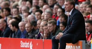 Liverpool manager Brendan Rodgers in contemplative mood as he watches his side during their match against Crystal Palace at Anfield on Saturday. Photograph: Phil Noble/Reuters