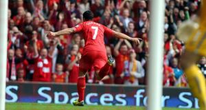 Liverpool's Luis Suarez celebrates scoring the opening goal against Crystal Palace.