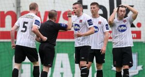 Dundalk's Chris Shields protests with referee Anthony Buttimer after he was shown a red card for a professional foul  in the FAI Cup semi-final at United park. Photograph: Ryan Byrne/Inpho
