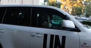 UN vehicles transporting a team of experts from the Organization for the Prohibition of Chemical Weapons (OPCW) return to their hotel in Damascus yesterday. The team of international experts have begun the process of destroying Syria's chemical gas arsenal. Photograph: Reuters
