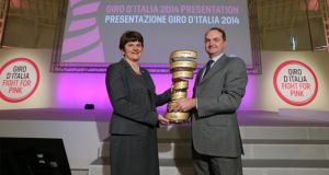 Northern Ireland tourism minister Arlene Foster  pictures with RCS Sport chief executive Riccardo Taranto at the Giro d'Italia launch at the Palazzo del Ghiaccio in Milan. Photograph: Inpho/Presseye
