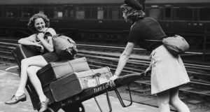 'Cook's Continental Timetable for 1939  has an incredible feeling of transience about it, quite apart from all the detail about long-forgotten possibilities in rail, steamer and air journeys around Europe and further afield.' Above, holidaymakers amuse themselves  while waiting for a train at Euston Station, London in August 1939. Photograph: AJ O'Brien/Fox Photos/Getty Images