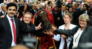 Sheikh Joaan Al Thani (left) owner of Treve and trainer Criquette Head-Maarek (right)  after winning the Qatar Prix de l'Arc de Triomphe at Longchamp. Photograph: Alan Crowhurst/Getty Images