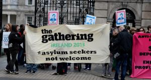Asylum seekers and human rights supporters protesting outside the Dáil against  the direct provision system earlier this year. Photograph: David Sleator