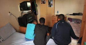 Asylum seekers at Millstreet Accommodation Centre,  Drishane Castle,  north Cork, during a protest over conditions  at the centre last June.