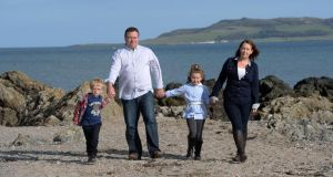 Susan Brown with her husband Peter and their children Alex and Eva on Donabate Strand. Photograph: Cyril Byrne