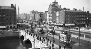 Changing times: photographs from Dublin City Council's new website bridgesofdublin.ie: O'Connell Bridge in 1905; after Easter Week, 1916; and in 2013. Photograph courtesy of the National Library of Ireland
