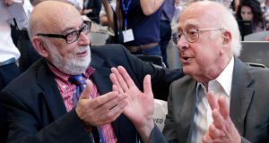 Physicists Francois Englert and Peter Higgs before a news conference on the search for the Higgs boson at CERN last year