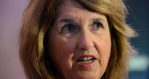 Minister for Social Protection Joan Burton: Fine Gael wants her to extract more from declining welfare budget.  Photograph: Cyril Byrne