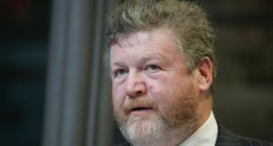Minister for Health  James Reilly: If health overrun is larger than expected it will have a knock-on effect on other departments. Photograph: Alan Betson