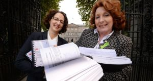 Dr Shari McDaid from the coalition Mental Health Reform presenting Minister of State for Mental Health Kathleen Lynch with a petition signed by over 21,000 people calling for the Government to invest an additional €35 million  in community mental health services next year. Photograph: Alan Betson