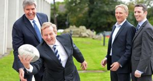 "Taoiseach Enda Kenny joking with Herb Hribar, Chief Executive eircom Group; Joe Schmidt Irish head coach; and Simon Boucher, CEO IMI, at the IMI National Management Conference ""Game Changers for Growth"", at Sandyford , Co Dublin, yesterday. Photograph: Eric Luke."