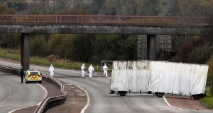 Forensic officers search the scene on the M1 near Belfast where prison officer David Black was shot near Lurgan last November. Photograph: Reuters