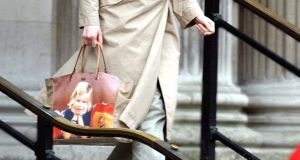 Claudia Schiffer's Anya Hindmarch bag, personalised with a photograph of her as a girl. Photograph: Antony Jones/UK Press/Getty