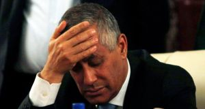 Libya's Prime Minister Ali Zeidan places his hand on his forehead as he addresses a news conference after his release and arrival at the headquarters of the Prime Minister's Office in Tripoli yesterday. Photograph: Reuters