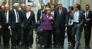 Leading members of the German Christian Democrats (CDU), including Chancellor Angela Merkel andHorst Seehofer (right of Merkel), chairman of the bavrian Christian Democrats (CSU), arrive for talks over a possible government coalition with the German Greens Party yesterday in Berlin. Photograph: Sean Gallup/Getty Images.