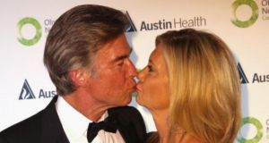 Olivia Newton-John and her husband John Easterling kiss as they arrive at the fundraising gala  in Melbourne last month. Photograph: Getty