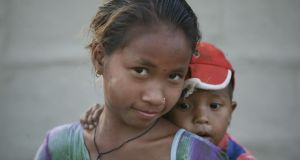 Nepal portraits: a Nepalese girl and her younger brother. Photograph: Alf Berg/Plan