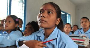 Nepal portraits: a former Kamalari girl at school. Photograph: Shona Hamilton/Plan