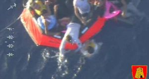 Video image made available by the Armed Forces of Malta shows a life raft carrying survivors  following the capsize of a boat carrying an estimated 200 migrants. (AP Photo/Armed Forces of Malta)