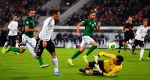 Mesut Özil of Germany scores his team's third against Ireland in Cologne. Photograph: Lars Baron/Bongarts/Getty Images