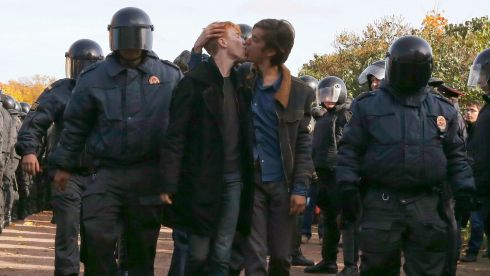 Gay rights activists kiss as they are detained by police officers during a weekend gay rights protest in St Petersburg. Photograph: Alexander Demianchuk/Reuters