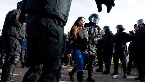 Police detain a gay rights activist. Photograph: Alexander Demianchuk/Reuters