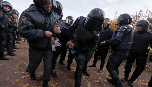 Police take away an anti-gay protester.  Photograph: Alexander Demianchuk/Reuters
